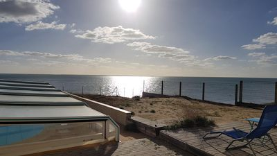 Photo for LARGE VILLA ON THE BEACH with private heated pool (La Grière district)