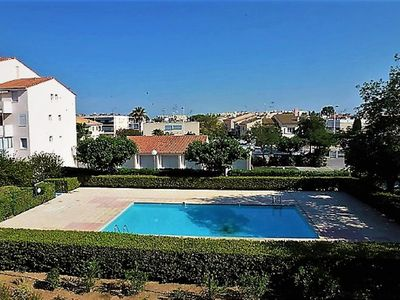 Photo for Well located, residential apartment with private pool and parking.