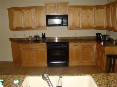Gourmet, fully stocked granite and maple kitchen.