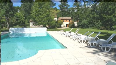 Photo for Two properties: 13th century manoir and mill, private garden & 12mtr heated poo