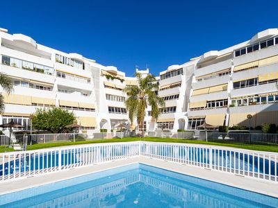 Photo for Central Apartment with Pool Access, Air Conditioning and Wi-Fi