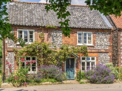 Photo for A beautifully styled flint character cottage with spacious accommodation.