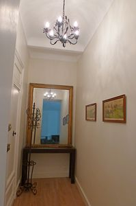 Elegant hallway with a double lock front door for more security.
