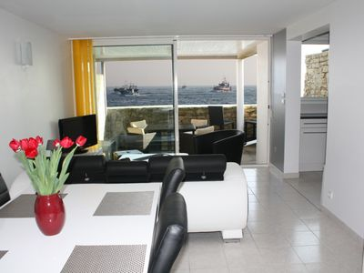 Photo for Beautiful sea view 50m from the beach and the harbor and shops and downtown on foot