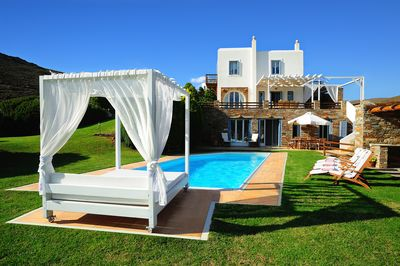 The outdoor of the villa with the garden and private pool