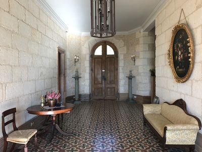The downstairs hall way and lobby area with it's beautiful original tiles