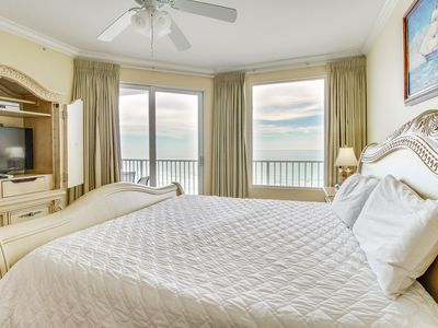 Photo for Beachfront condo with ocean views and shared pool - easy beach access!