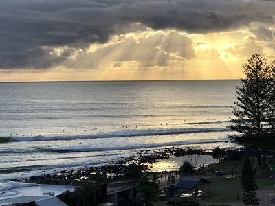 Surfers taking in sunrise at Burleigh Point.