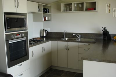 Full kitchen facilites with modern appliances. Complete with breakfast bar.