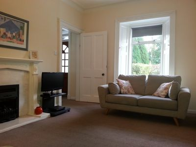 Living room with living flame gas fire.
