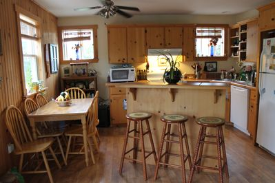 Kitchen eating area with island & all appliances.