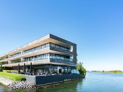 Photo for Spacious and luxurious apartment by the lake near Veere