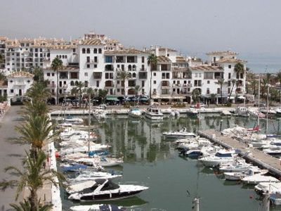 Photo for Perfectly situated apartment overlooking marina with superb views