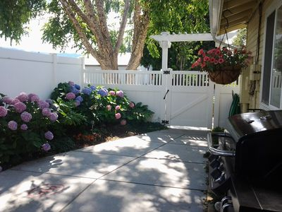 Courtyard Entry invites you to enjoy this shady summertime retreat.