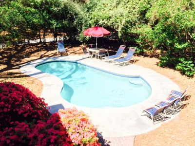 Plenty of seating and sunshine in pool area off back deck with azaleas in bloom