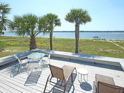 Photo for Waterfront vacation home w/ shared pool and huge deck, walk to the beach!