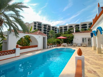 Photo for This 4-bedroom villa for up to 8 guests is located in Albir and has a private swimming pool, air-con