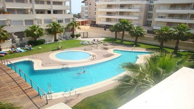 Photo for Modern apartment on the beach with large communal pool, fitness, air conditioning