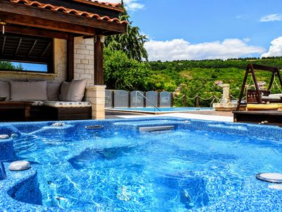 Photo for Boutique villa COOK with pool, jacuzzy and sea view