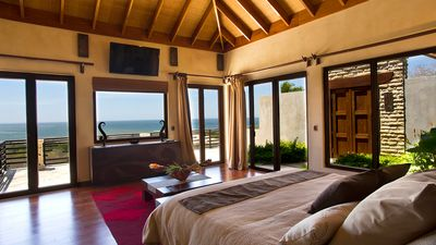Master bedroom unspoiled ocean views through out .