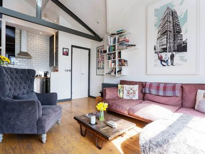 Photo for Bright and quirky apartment with brick-wall rooms and an artistic touch (Veeve)