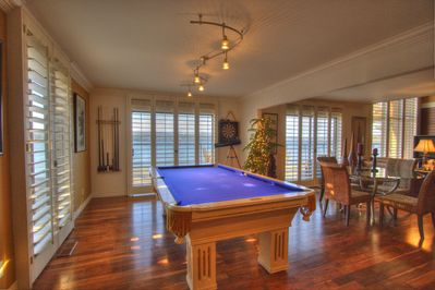 Pool table off kitchen and living room with views of the Puget Sound.