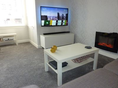Lounge with 50inch Smart TV offering Netflix, BBC Player, HD Freeview and more.