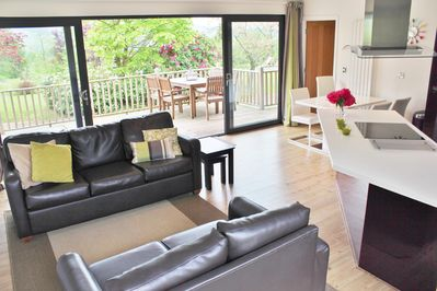The sliding doors open out onto the generously proportioned deck