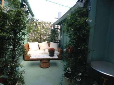 ROOFTOP GARDEN TERRACE is private and full of flowering vines