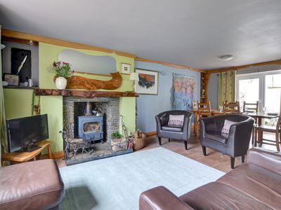 Photo for This painted stone cottage, semi-detached to another, is full of character and original features, ye