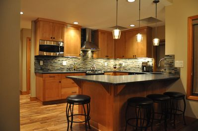 Well appointed kitchen with granite and SS appliances
