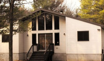 Walk through the double doors of the White Rabbit Cottage single family home
