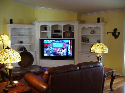 entertainment unit with 60 inch plasma TV and surround sound