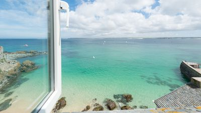 Photo for 3a Sea View Place overlooks crystal clear waters and Bamaluz beach. Sea front and stunning! Within walking distance of heart of St Ives. Free WiFi.
