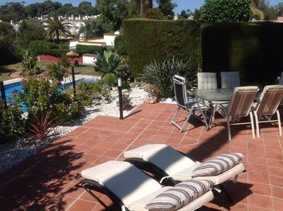 Our garden terrace overlooking the beautiful pool.