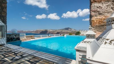 Photo for Akrotiri Villa Santorini caldera view 5 bedrooms up to 10 guests private pool