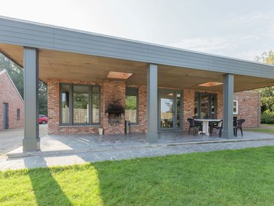 Photo for Stylish holiday farm with open fire located at the edge of Overpelt