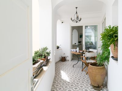 Photo for Modern, comfortable, comfortable, 3 minutes from the square, view of Faraglioni