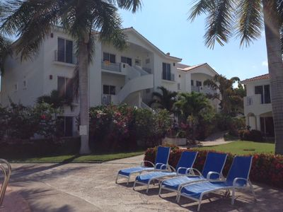 Photo for Condo in private Golf Course with tropical surroundings 24 hrs security