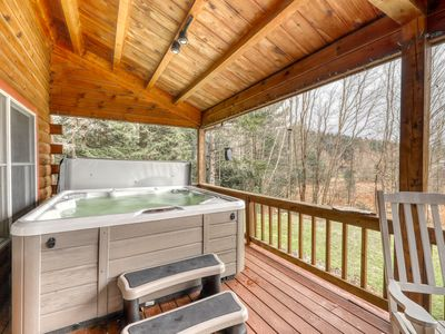 Photo for Modern & rustic home w/ spacious deck, private hot tub, fireplace & forest view!