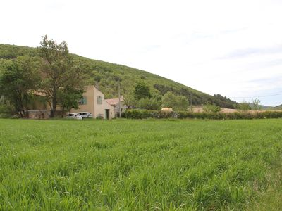 Photo for Provencal farmhouse with private pool in the inner courtyard