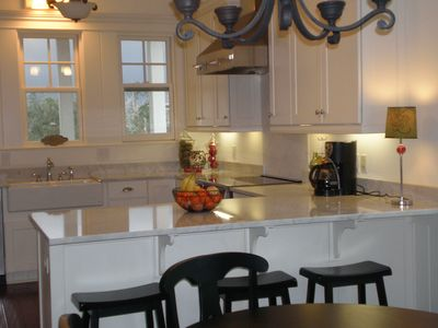 Carrera marble counters, Farmhouse sink, stainless steel appliances,