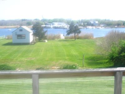 View from the deck of the yard, dock and cove