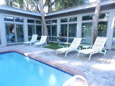 Photo for FREE POOL HEAT INCLUDED Spring/Fall. 6 minute Direct Walk to Beach Pet Friendly