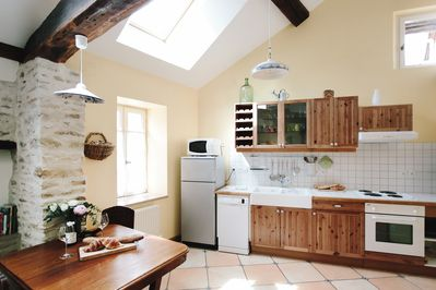 The fully equipped kitchen area. Soaring ceilings and plenty of natural light.