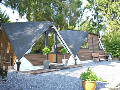 Photo for Unusual chalet in the woods, very comfortable, nice covered terrace, quiet