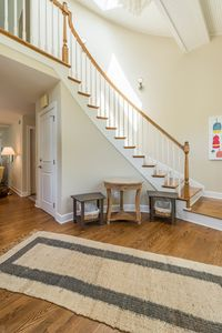 The entry has a sweeping stair & is the perfect welcome to this premier home.