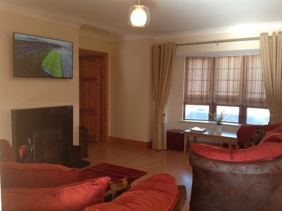 Comfortable Sitting Area with Solid Fuel Stove & Smart TV + Netflix