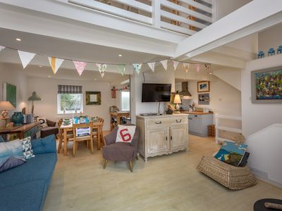 Photo for This contemporary three storey property with shabby chic styling and large balcony with sea views ma