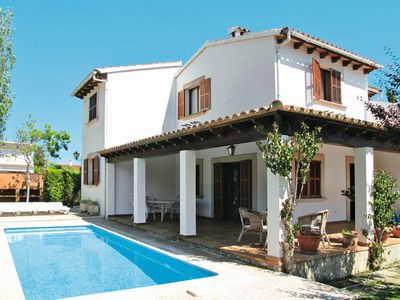 Photo for 4 bedroom Villa, sleeps 8 with Pool, WiFi and Walk to Beach & Shops